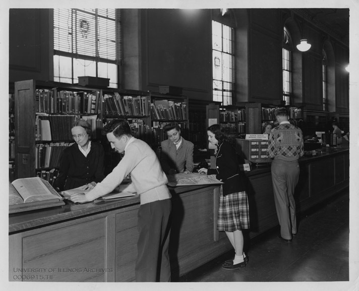 Staff members assist students at the reference desk, December 11, 1946