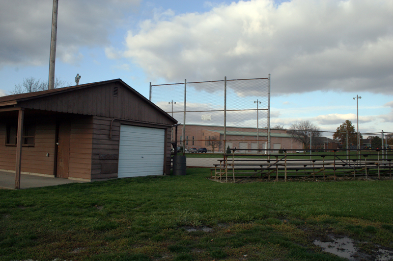 concession stand, bleachers, and baseball diamond