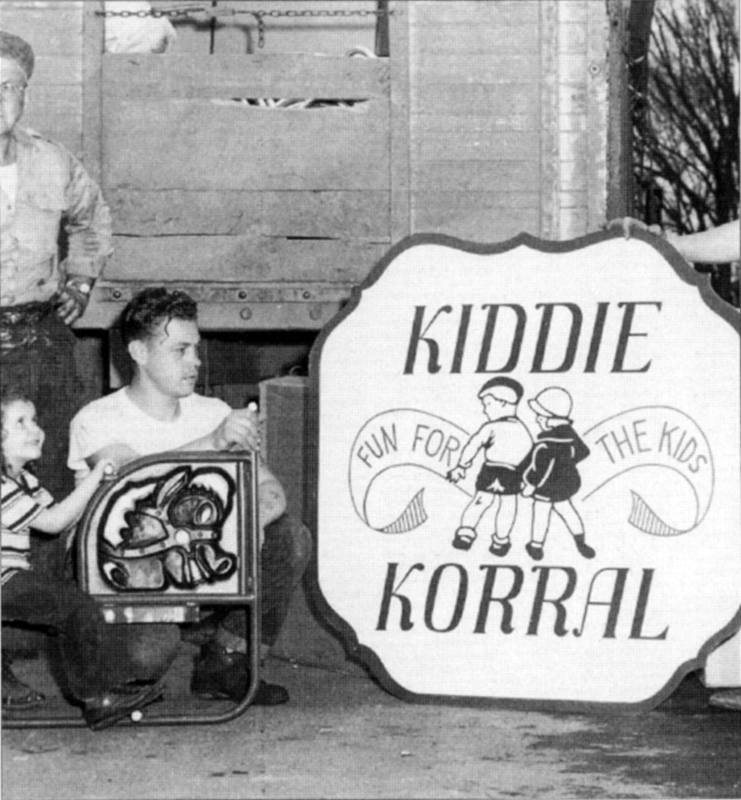 "child playing on the ""Kiddie Korral,"""