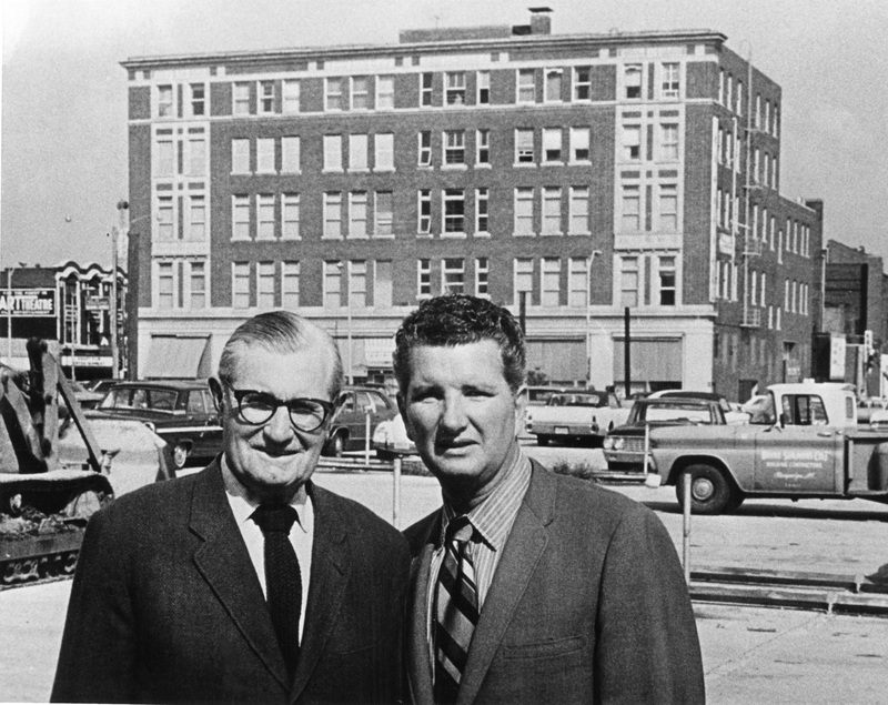 Two men pose in front of the Robeson Building, January 1971