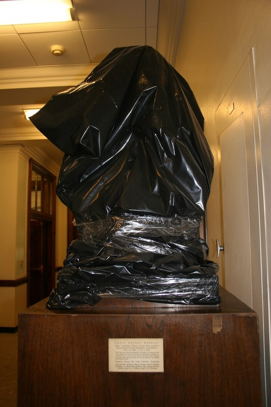 Editor's Hall of Fame bust covered in a plastic bag