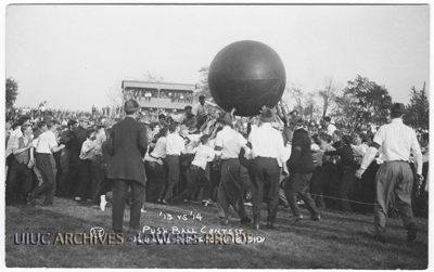 The class of 1913 and 1914 compete against each other in the push ball contest, which was part of the homecoming festivities, a contest that the sophomores (class of 1913) won.