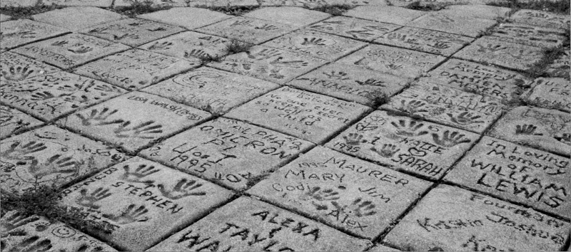 Stepping stones at PrairiePlay playground made in honor of donors and volunteers